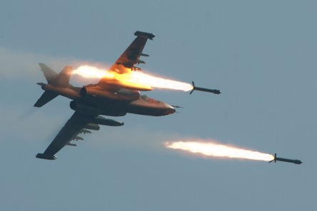 A Su-25 fires a volley of unguided heavy rockets