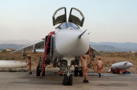 RuAF airmen work on a Su-24M2 at the Khmeimim airbase in Syria