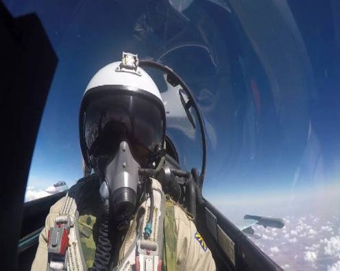A Su-30SM pilot takes a selfie during a routine mission over Syria