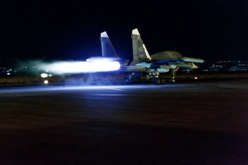Su-34 taking off at night, loaded with KAB-500S bombs