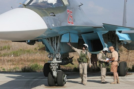 A Russian pilot inspects his Su-34 prior to a mission